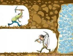 picture of 2 people on different levels cutting in to rock, with one giving up just before he reaches success.